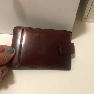 Tumi men's wallet with wristlet on the back
